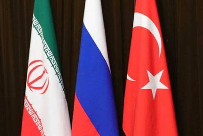 Russia, Turkey and Iran working to agree on date for Syria summit