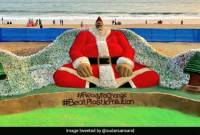 Indian sand artist creates huge Santa Claus using 10000 plastic bottles to raise awareness on 
